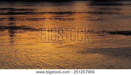 Photography showing a sundown. The photography was taken from the street of the city of Avignon, France. poster