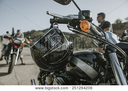 Malaga, Spain - July 15, 2018: Black Helmet From Harley Davidson Brand Hanging From A Harley Davidso