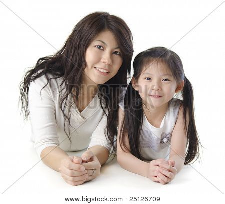 Asian mother and her daughter on white background