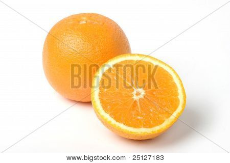 Two Oranges, One Intersected To Half. With Clipping Path