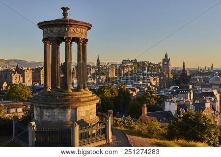 Edinburgh Sunset View With Dugald Steward Monument And Edinburgh Castle In The Background, Scotland,