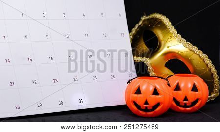 31 October On Calendar With Fantasy Mystery Golden Mask & Scary Pumpkin - Halloween Day Concept.
