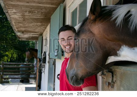 Good Looking Horse Rider Prepared To Go Horse Riding With His Horse At Stables On His Farm Ranch