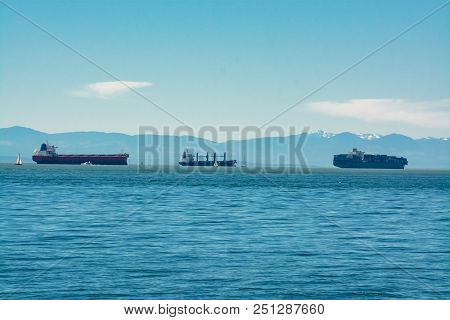 Seagoing vessels passing a harbor. Ship traffic to a port. Congestion of shipping poster