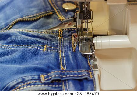Sewing Machine Repair Jeans Trousers, Close-up. Sewing Machine Repair Jeans Trousers, Close-up.