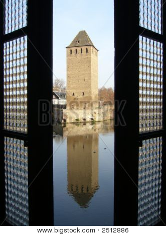 Tower And Reflection Through The Window