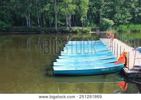 St. Petersburg, Russia - July 15, 2018: Boat Station With Small Boats For Rent On Lake Water. Summer