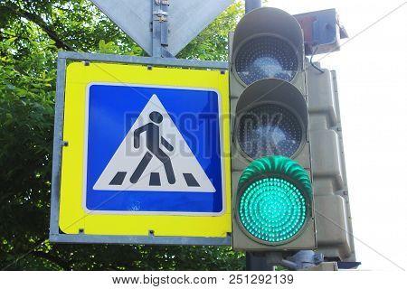 Green Traffic Light And Pedestrian Crosswalk Traffic Stop Sign Close Up View. Crosswalk At City Stre