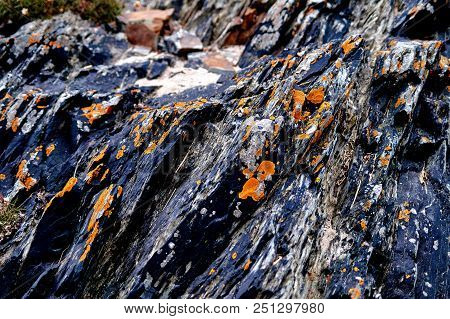Close Up Of Dark Rocks At The Beach In The South-east Of Ireland