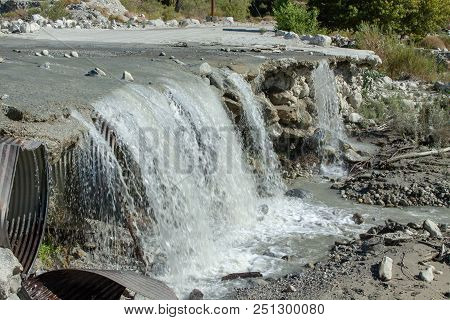 Collapse Of A Road After A Quake Now A Waterfall
