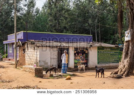 Belathur, Karnataka, India - November 1, 2013: Owner Stands In Front Of Humble Grocery Store Build I