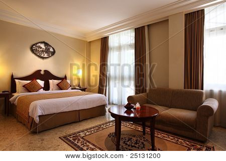 Interior of a luxury hotel bedroom poster