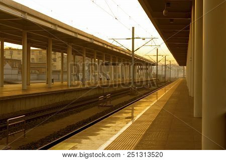Train Railroad Tracks At China  Pint-sized Station At Sunrise.
