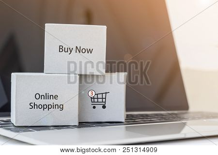 Stack Of Cardboard Boxs Is Located On Laptop Keyboard. Consumers Can Buy Products Directly  From Sel