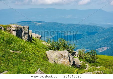 Boulders On A Grassy Slope. Beautiful Summer Scenery. Lovely Nature Background