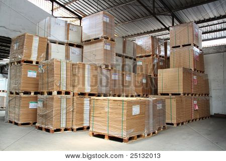 Stack of product on pallets in warehouse