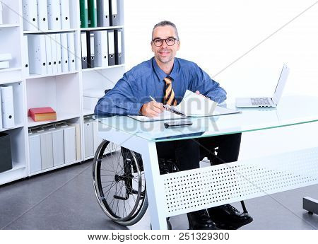 disabled business man in wheelchair working  in the office poster