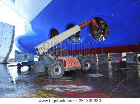 Ship Repair. Under The Ship. Big Ship Under Repairing On Dry Dock In Shipyard