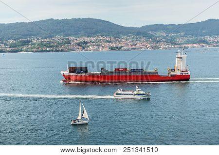 Vigo, Spain - May 20, 2017: Ships And Yacht Sailing On The Vigo Inlet On Its Way To Vigo And Back, G