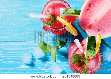 Watermelon Summer Cocktail With Ice And Mint Leaves. Cold Refreshment Organic Non-alcohol Drink On P