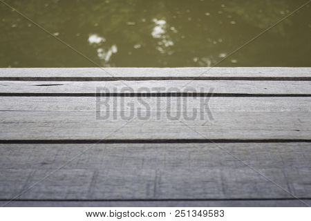 Old Weathered Wooden Plank Walkway Over River, Stock Photo