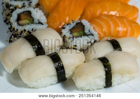 Assortment Of Fresh Sushi, Sushi With Salmon, Butterfish, Rolls With Smoked Salmon, Avocado And Whit