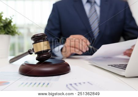Justice Symbol Wooden Gavel On Table. Attorney Working In Office