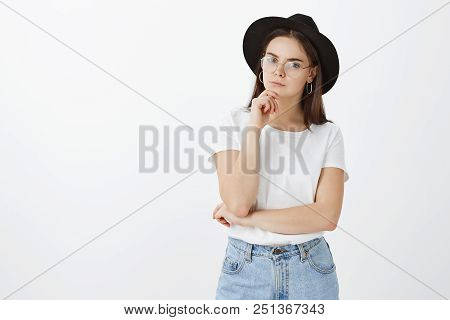 Hmm, Interesting Idea, Need To Think About It. Stylish Caucasian Woman In Hat And Glasses Touching C