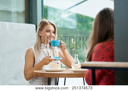 Two Female Friends Having Drinking Coffee, Talking. Laughing, Having Good Time, Laughing, Smiling, D