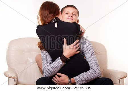 Young Man Embraces Woman