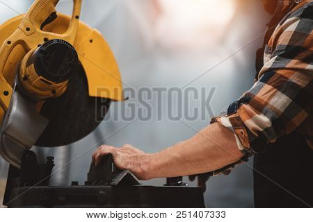 Strong Bearded Mechanic Use Angular Grinding Machine In Metalworking Plant. Work In Service Station.