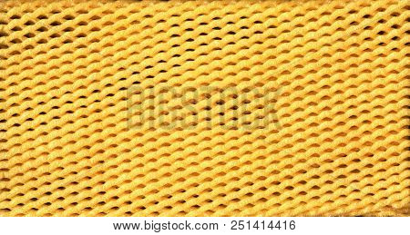 Yellow Epe Fruit Net Abstract Close-up Background. Expanded Polyethylene Foam Net Macro Texture