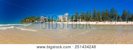 GOLD COAST, AUS - JULY 8 2018: Gold Coast skyline and surfing beach at Burleigh Heads, Queensland, Australia