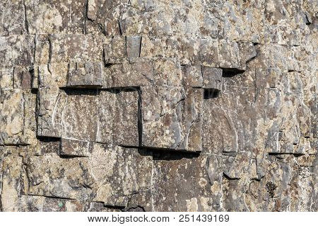 Geometric Pattern On A Steep Mountain Rock. Photo Shows A Stone Texture. The Texture Of The Stone, I