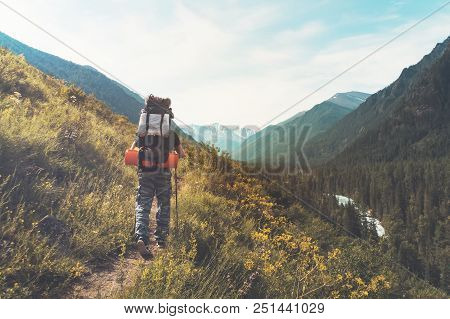 Tourist With Hiking Backpacks In Mountain Hike On Summer Day. Tourist In Beautiful Mountain Landscap