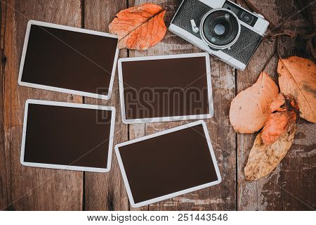 Retro Camera With Paper Photo Frame For Add Picture. Memories And Nostalgia In Fall (autumn) Concept