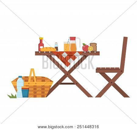 Wooden Picnic Table And Chairs With Cloth, Juice Jar, Fruits, Straw Basket And Bread. Outdoor Dining