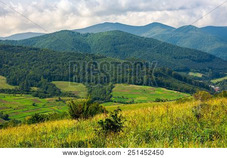 Lovely Rural Scenery In Mountains. Agricultural Fields On Hills. Beautiful Landscape