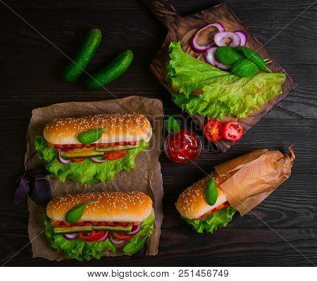 Homemade Sandwiches Sausages In Buns (hot Dogs). Ingredients For Hot Dogs Onions, Fresh Lettuce, Tom