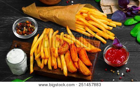 Organic Food - French Fries, Baked Potatoes In Rustic Pieces In The Skin. Ingredients For French Fri