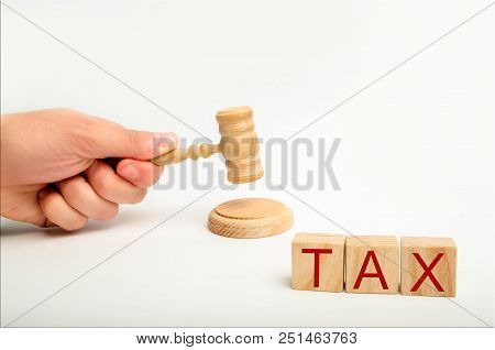 Tax Law Concept With A Gavel. Tax Court Judgments. Judge's Hand And The Inscription