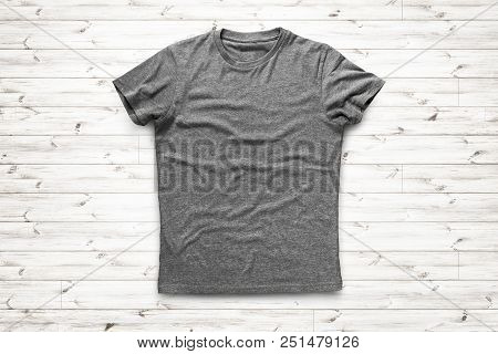 Grey Shirt Is Over Light Wood Background