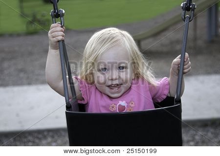 Happy Child in Swing