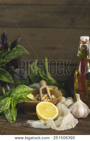 Many Food Ingredients For Making Pesto On Dark Wooden Background