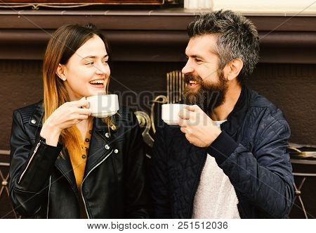 Hot Beverage And Lunch Time Concept. Woman And Man With Happy Faces Have Date At Cafe. Couple In Lov