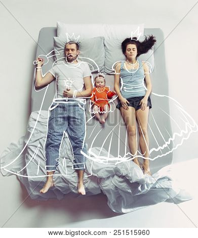 Top View Of Happy Funny Family With One Newborn Child In Bedroom. Enjoying Being Together. Happy Fam
