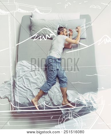 Top View Photo Of Young Man Sleeping In A Big White Bed. Dreams Concept. He Dreaming About Travel, S