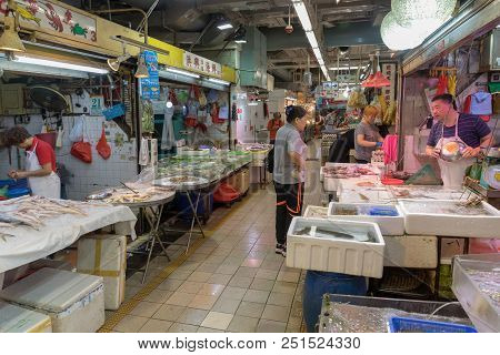 Kowloon, Hong Kong - April 21, 2017: Fa Yuen Street Farmers Market Interior With Fishmongers In Kowl
