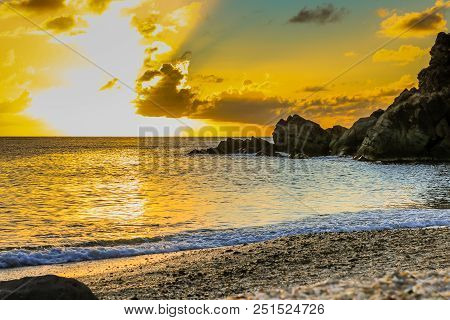 Travel Photo In St. Barths, Caribbean. Amazing View Of Sunset On Shell Beach In Gustavia, Caribbean.