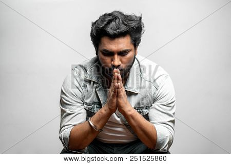 Man Hoping For The Best. Sadness, Sorrow Concept. Upset Man In Praying Pose
